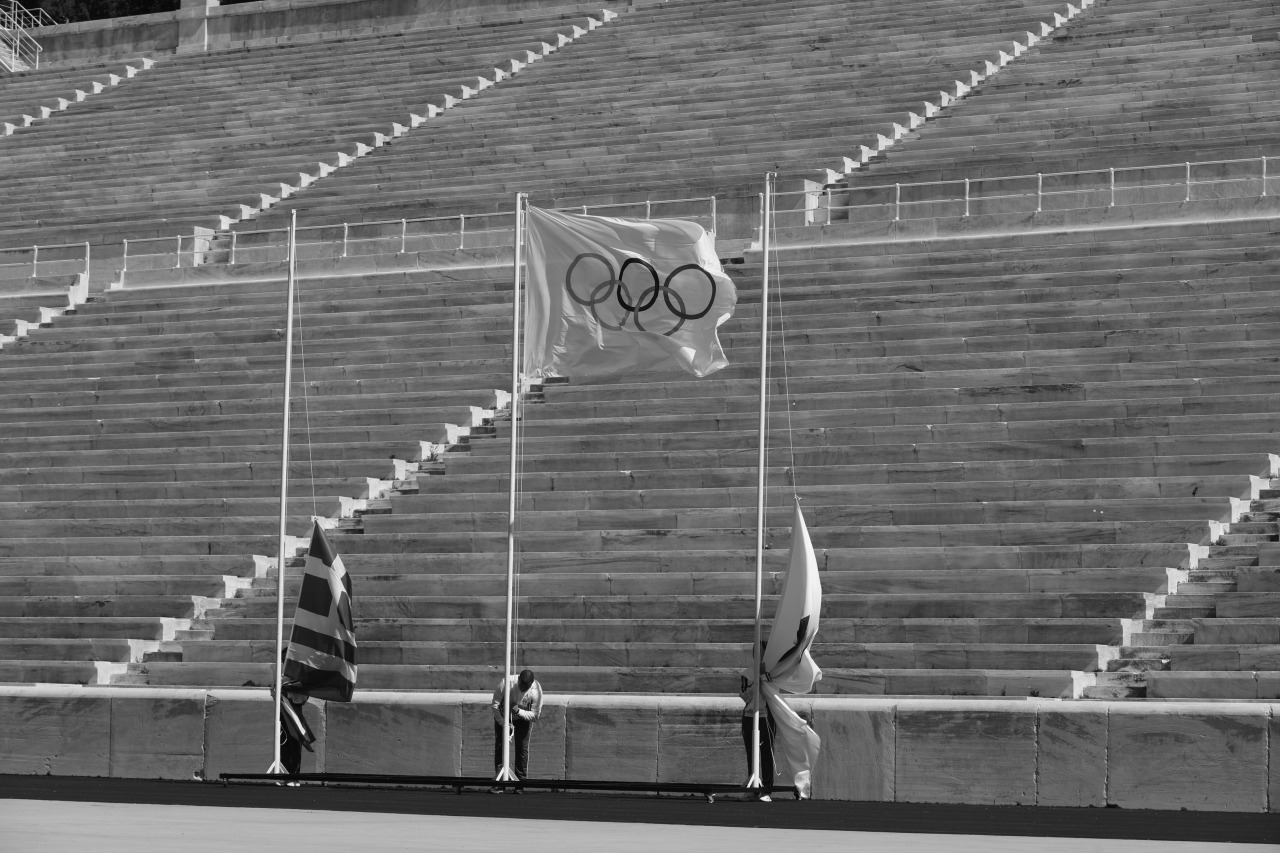Olympic flag raising. Japanese and Greek too? Photo: IOC